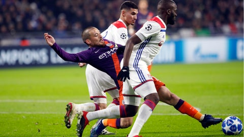 <p>               Manchester City midfielder David Silva is sandwiched by Lyon players Tanguy Ndombele, right, and Houssem Aouar during a Champions League Group F second leg soccer match between Lyon and Manchester City in Decines, near Lyon, central France, Tuesday, Nov. 27, 2018. (AP Photo/Laurent Cipriani)             </p>