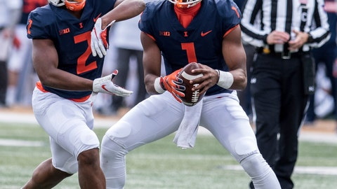 <p>               Illinois quarterback AJ Bush, Jr. (1) hands the ball off to running back Reggie Corbin (2) in the first half of a NCAA college football game aganist Minnesota, Saturday, Nov. 3, 2018, in Champaign, Ill. (AP Photo/Holly Hart)             </p>
