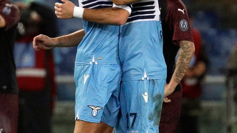 <p>               Lazio's Joaquin Correa, left, celebrates with Ciro Immobile after scoring his side's first goal during a Serie A soccer match between Lazio and AC Milan, at the Rome Olympic stadium, Sunday, Nov. 25, 2018. (AP Photo/Gregorio Borgia)             </p>