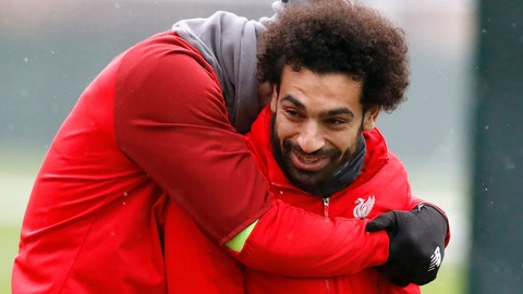 <p>               Liverpool's Dejan Lovren, left, and Mohamed Salah attend a training session at Melwood Training Centre, Liverpool, England, Tuesday Nov. 27, 2018. (Martin Rickett/PA via AP)             </p>