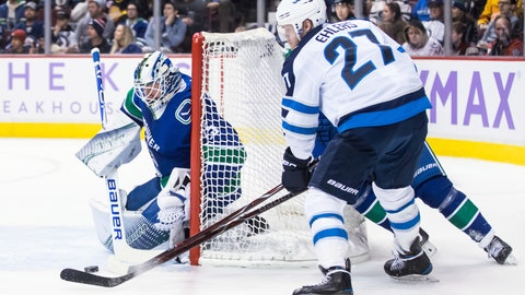 <p>               Winnipeg Jets' Nikolaj Ehlers (27), of Denmark, attempts a wrap-around on Vancouver Canucks goalie Jacob Markstrom, left, of Sweden, as Ben Hutton, back right, defends during the first period of an NHL hockey game in Vancouver, British Columbia, Monday Nov. 19, 2018. (Darryl Dyck/The Canadian Press via AP)             </p>