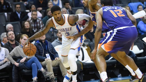<p>               Oklahoma City Thunder forward Paul George (13) tries to push past Phoenix Suns forward Trevor Ariza (3) and T.J. Warren (12) in the second half of an NBA basketball game in Oklahoma City, Monday, Nov. 12, 2018. (AP Photo/Kyle Phillips)             </p>