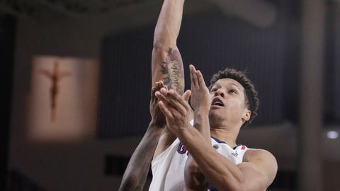 <p>               Gonzaga forward Brandon Clarke, right, shoots while defended by North Dakota State guard Vinnie Shahid during the second half of an NCAA college basketball game in Spokane, Wash., Monday, Nov. 26, 2018. (AP Photo/Young Kwak)             </p>