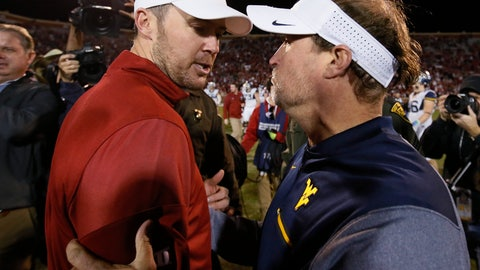 <p>               FILE - In this Nov. 25, 2017, file photo, Oklahoma head coach Lincoln Riley, left, and West Virginia head coach Dana Holgorsen, right, talk after their NCAA college football game in Norman, Okla. No. 6 Oklahoma or No. 7 West Virginia can get into the Big 12 championship game by winning their last two games. Since those Top 10 teams still have to play each other in the regular season, it is impossible for both to win their last two games. But the three-time defending Big 12 champion Sooners (9-1, 6-1 Big 12) and Mountaineers (8-1, 6-1) could also still face each other two weeks in a row _ in that day-after-Thanksgiving game in Morgantown, and then Dec. 1 for the conference title. (AP Photo/Sue Ogrocki, File)             </p>