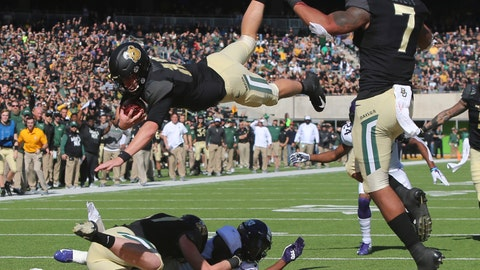 <p>               Baylor quarterback Charlie Brewer, center, dives over the goal line for a touchdown in the first half of an NCAA college football game against TCU, Saturday, Nov. 17, 2018, in Waco, Texas. (Michael Bancale/Waco Tribune Herald, via AP)             </p>