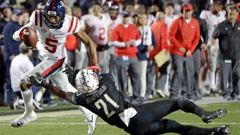 <p>               Mississippi wide receiver DaMarkus Lodge (5) gets past Vanderbilt cornerback Donovan Sheffield (21) in the first half of an NCAA college football game Saturday, Nov. 17, 2018, in Nashville, Tenn. (AP Photo/Mark Humphrey)             </p>