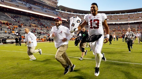 <p>               Alabama quarterback Tua Tagovailoa (13) celebrates as he leaves the field after an NCAA college football game against Tennessee Saturday, Oct. 20, 2018, in Knoxville, Tenn. Alabama won 58-21. (AP Photo/Wade Payne)             </p>