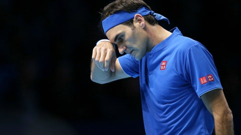 <p>               Switzerland's Roger Federer wipes his face during his ATP World Tour Finals singles final tennis match against Japan's Kei Nishikori at the O2 Arena in London, Sunday Nov. 11, 2018. (AP Photo/Tim Ireland)             </p>