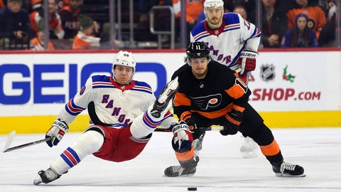 <p>               Philadelphia Flyers' Travis Konecny, right, upends New York Rangers' Lias Andersson as they fight for the puck during the third period of an NHL hockey game, Friday, Nov. 23, 2018, in Philadelphia. The Flyers won 4-0. (AP Photo/Derik Hamilton)             </p>