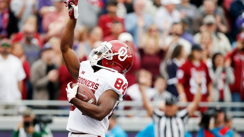 <p>               FILE - In this Saturday, Oct. 20, 2018, file photo, Oklahoma wide receiver Lee Morris (84) points skyward after scoring a touchdown during the first half of an NCAA college football game against TCU in Fort Worth, Texas. Oklahoma receiver Lee Morris and Oklahoma State quarterback Taylor Cornelius are among the top players in the nation who started their careers as walk-ons.  (AP Photo/Brandon Wade, File)             </p>
