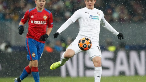 <p>               Plzen midfielder Jan Kopic, right, and CSKA forward Fyodor Chalov fights for the ball during the Group G Champions League soccer match between CSKA Moscow and Viktoria Plzen at the Luzhniki Stadium in Moscow, Russia, Tuesday, Nov. 27, 2018. (AP Photo/Pavel Golovkin)             </p>