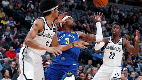 <p>               Denver Nuggets forward Torrey Craig, center, tries to pull in a loose ball between Brooklyn Nets center Jarrett Allen, left, and guard Caris LeVert in the first half of an NBA basketball game, Friday, Nov. 9, 2018, in Denver. (AP Photo/David Zalubowski)             </p>