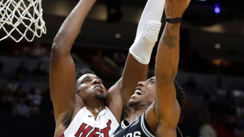 <p>               San Antonio Spurs guard DeMar DeRozan (10) drives as Miami Heat center Hassan Whiteside defends during the second half of an NBA basketball game, Wednesday, Nov. 7, 2018, in Miami. The Heat won 95-88. (AP Photo/Lynne Sladky)             </p>