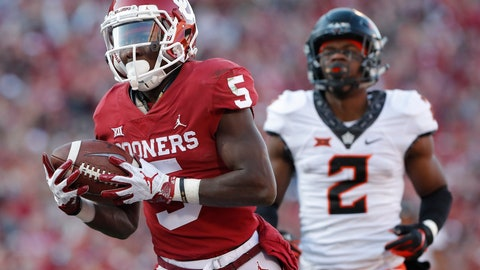 <p>               FILE - In this Nov. 10, 2018, file photo, Oklahoma wide receiver Marquise Brown (5) runs in for a touchdown ahead of Oklahoma State cornerback Tanner McCalister (2) in the second quarter of an NCAA college football game in Norman, Okla. The Sooners and Longhorns are loaded with playmakers on the outside, but the ones with the best case to be All-Americans are Oklahoma's Marquise Brown and Texas' Lil'Jordan Humphrey. (AP Photo/Alonzo Adams, File)             </p>