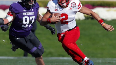<p>               FILE - In this Oct. 13, 2018, file photo, Nebraska's Adrian Martinez, right, runs upfield past Northwestern's Joe Gaziano during the first half of an NCAA college football game, in Evanston, Ill. Martinez leads a Nebraska offense that has gone over 450 yards of total offense in seven straight games for the first time in program history. (AP Photo/Jim Young, File)             </p>
