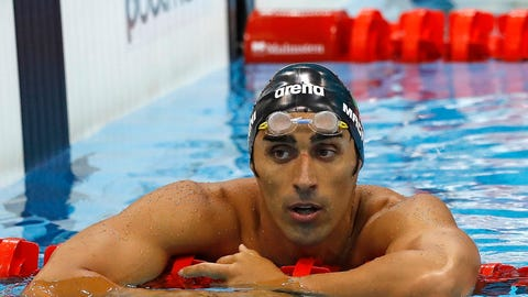 <p>               FILE - In this Monday, May 16, 2016 filer, Italy's Filippo Magnini reacts after anchoring his team to the silver medal in the final of the Men's 4x100m freestyle relay during the European Aquatics Championships at the London Aquatics Centre in London. Two-time swimming world champion Filippo Magnini has been banned for four years for doping. Italy's anti-doping agency issued the verdict for the retired swimmer on Tuesday, Nov. 6, 2018, and gave the same sentence to Magnini's relay teammate, Michele Santucci. (AP Photo/Matt Dunham, File)             </p>