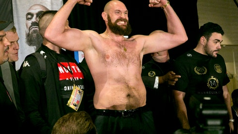 <p>               Boxer Tyson Fury flexes after exchanging words with opponent Deontay Wilder at a news conference in Los Angeles, Wednesday, Nov. 28, 2018, ahead of their heavyweight world championship boxing match at Staples Center, on Dec. 1. (AP Photo/Damian Dovarganes)             </p>