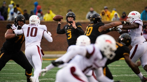 <p>               Missouri quarterback Drew Lock, center, throws a pass during the first half of an NCAA college football game against Arkansas, Friday, Nov. 23, 2018, in Columbia, Mo. (AP Photo/L.G. Patterson)             </p>