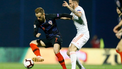 <p>               Croatia's Ivan Rakitic, left, challenges for the ball with with Spain's Saul Niguez during the UEFA Nations League soccer match between Croatia and Spain at the Maksimir stadium in Zagreb, Croatia, Thursday, Nov. 15, 2018. (AP Photo/Darko Bandic)             </p>