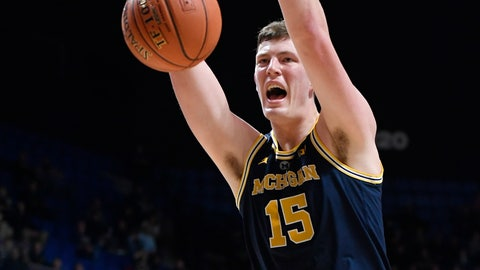 <p>               Michigan's Jon Teske (15) dunks during the second half of an NCAA college basketball game against Providence, Sunday, Nov. 18, 2018, in Uncasville, Conn. (AP Photo/Jessica Hill)             </p>