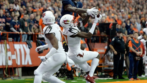 <p>               Louisville cornerback Anthony Johnson, center, breaks up a pass intended for Syracuse wide receiver Jamal Custis during the first half of an NCAA college football game in Syracuse, N.Y., Friday, Nov. 9, 2018. (AP Photo/Adrian Kraus)             </p>