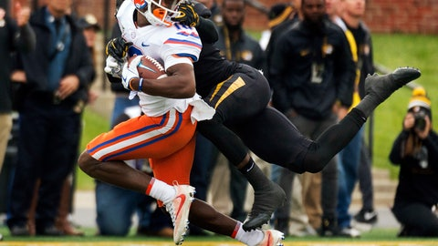 <p>               FILE - In this Nov. 4, 2017, file photo, Florida wide receiver Josh Hammond, left, is tackled by Missouri's DeMarkus Acy, right, as he grabs his face mask during the first half of an NCAA college football game in Columbia, Mo. No. 13 Florida is counting on a much better performance against Missouri this season. A lopsided loss to the Tigers was the low point for Florida in 2017. (AP Photo/L.G. Patterson, File)             </p>