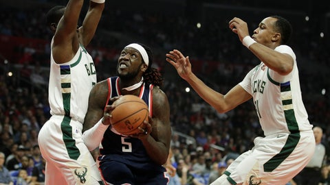 <p>               Los Angeles Clippers' Montrezl Harrell, center, looks to shoot under pressure by Milwaukee Bucks' Tony Snell, left, and John Henson during the first half of an NBA basketball game Saturday, Nov. 10, 2018, in Los Angeles. (AP Photo/Jae C. Hong)             </p>