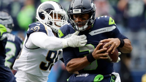 <p>               FILE - In this Oct. 7, 2018, file photo, Seattle Seahawks quarterback Russell Wilson, right, is sacked by Los Angeles Rams defensive tackle Aaron Donald, left, during the first half of an NFL football game, Sunday, in Seattle. With the second-place Seahawks visiting the Coliseum on Sunday for a rematch, the Rams have a chance to essentially end the division race with seven weeks to go. (AP Photo/Scott Eklund, File)             </p>