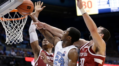 <p>               North Carolina's Kenny Williams (24) drives to the basket while Stanford's Josh Sharma (20) and KZ Okpala defend during the first half of an NCAA college basketball game in Chapel Hill, N.C., Monday, Nov. 12, 2018. (AP Photo/Gerry Broome)             </p>