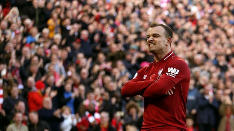 <p>               Liverpool's Xherdan Shaqiri celebrates scoring his side's second goal of the game,  during the English Premier League soccer match between Liverpool and Fulham, at Anfield Stadium, in Liverpool, England, Sunday, Nov. 11, 2018. (Barrington Coombs/PA via AP)             </p>