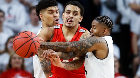<p>               Ohio State's Duane Washington Jr., center, battles against Cincinnati's Justin Jenifer, right, and Jarron Cumberland, left, during the first half of an NCAA college basketball game Wednesday, Nov. 7, 2018, in Cincinnati. (AP Photo/John Minchillo)             </p>