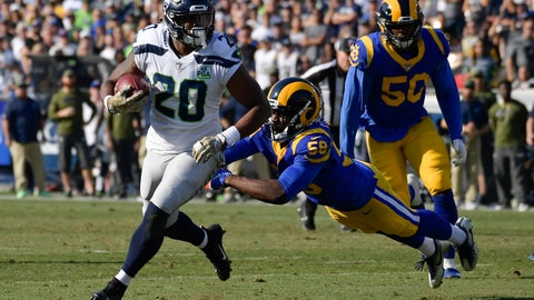 <p>               Seattle Seahawks running back Rashaad Penny, left, scores past Los Angeles Rams inside linebacker Cory Littleton during the first half in an NFL football game Sunday, Nov. 11, 2018, in Los Angeles. (AP Photo/Mark J. Terrill)             </p>