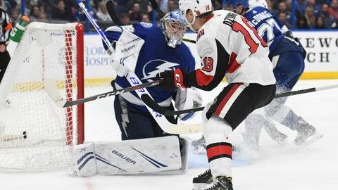<p>               Ottawa Senators left wing Ryan Dzingel (18) scores past Tampa Bay Lightning goaltender Andrei Vasilevskiy (88) during the third period of an NHL hockey game Saturday, Nov. 10, 2018, in Tampa, Fla. (AP Photo/Jason Behnken)             </p>