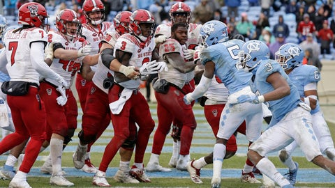 <p>               North Carolina State, left, and North Carolina players scuffle following the game-winning touchdown by North Carolina State's Reggie Gallaspy II (25) in overtime of an NCAA college football game in Chapel Hill, N.C., Saturday, Nov. 24, 2018. North Carolina State won 43-28. (AP Photo/Gerry Broome)             </p>