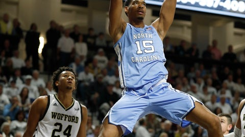 <p>               North Carolina's Garrison Brooks (15) dunks over Wofford's Keve Aluma (24) during the first half of an NCAA college basketball game in Spartanburg, S.C., Tuesday, Nov. 6, 2018. (AP Photo/Bob Leverone)             </p>