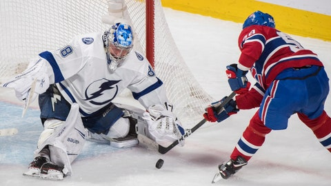 <p>               Montreal Canadiens' Noah Juulsen moves in on Tampa Bay Lightning goaltender Andrei Vasilevskiy during the second period of an NHL hockey game Saturday, Nov. 3, 2018, in Montreal. (Graham Hughes/The Canadian Press via AP)             </p>