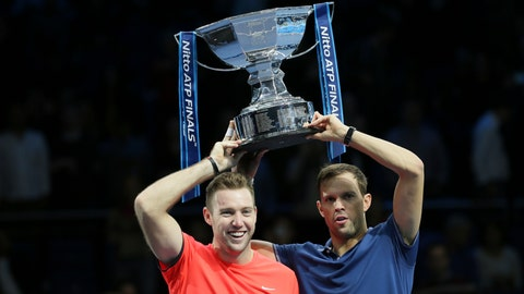 <p>               Mike Bryan, right, and Jack Sock of the United States hold up their trophy after defeating Pierre-Hugues Herbert and Nicolas Mahut of France during their ATP World Tour Finals doubles final tennis match at the O2 Arena in London, Sunday Nov. 18, 2018. (AP Photo/Tim Ireland)             </p>