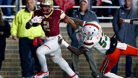 <p>               Boston College running back AJ Dillon (2) breaks a tackle byMiami linebacker Zach McCloud (53) on a touchdown run during the second half of an NCAA college football game in Boston, Friday, Oct. 26, 2018. (AP Photo/Michael Dwyer)             </p>