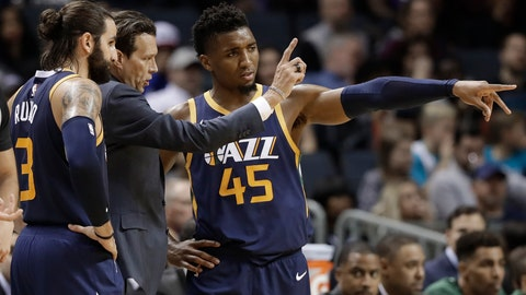 <p>               Utah Jazz head coach Quin Snyder, center, talks with Donovan Mitchell, right, and Ricky Rubio, left, during the second half of an NBA basketball game against the Charlotte Hornets in Charlotte, N.C., Friday, Nov. 30, 2018. (AP Photo/Chuck Burton)             </p>