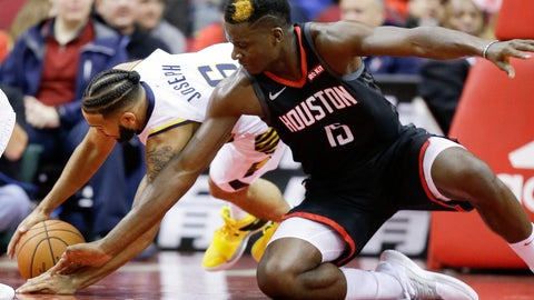 <p>               Houston Rockets center Clint Capela, right, and Indiana Pacers guard Cory Joseph chase a loose ball during the first half of an NBA basketball game, Sunday, Nov. 11, 2018, in Houston. (AP Photo/Eric Christian Smith)             </p>