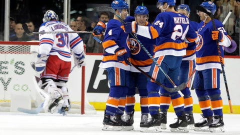 <p>               New York Islanders' Anthony Beauvillier, third from left, celebrates with teammates after scoring a goal as New York Rangers goaltender Henrik Lundqvist (30) stands in front of the goal during the first period of an NHL hockey game Thursday, Nov. 15, 2018, in New York. (AP Photo/Frank Franklin II)             </p>