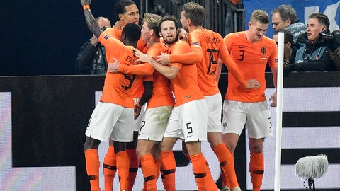 <p>               Netherland's Virgil Van Dijk is celebrated by his team after scoring his side's second goal in the 90th minute during the UEFA Nations League soccer match between Germany and The Netherlands in Gelsenkirchen, Monday, Nov. 19, 2018. The match ended 2-2. (AP Photo/Martin Meissner)             </p>