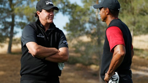 <p>               Phil Mickelson, left, and Tiger Woods talk at the first tee before a golf match at Shadow Creek golf course, Friday, Nov. 23, 2018, in Las Vegas. (AP Photo/John Locher)             </p>