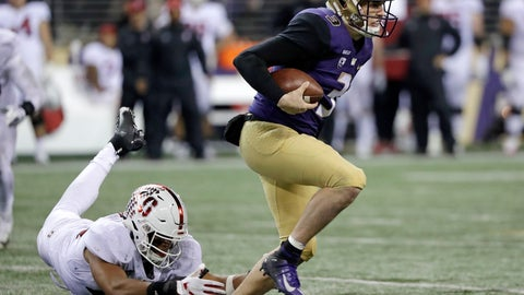 <p>               Washington quarterback Jake Browning, right, escapes a tackle attempt by Stanford's Jordan Fox during the second half of an NCAA college football game Saturday, Nov. 3, 2018, in Seattle. Washington won 27-23. (AP Photo/Elaine Thompson)             </p>