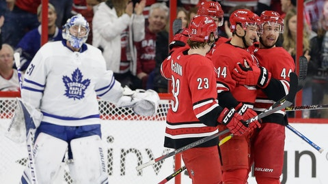 <p>               Carolina Hurricanes' Justin Williams (14) is congratulated by Brock McGinn (23), Calvin de Haan (44) and Jordan Staal, rear, following Williams' goal against Toronto Maple Leafs goalie Frederik Andersen, left, of Denmark, during the first period of an NHL hockey game in Raleigh, N.C., Wednesday, Nov. 21, 2018. (AP Photo/Gerry Broome)             </p>