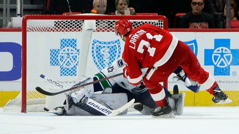 <p>               Detroit Red Wings center Dylan Larkin (71) puts his shot past the skate of Vancouver Canucks goaltender Jacob Markstrom (25), of Sweden, during the shootout in overtime of an NHL hockey game Tuesday, Nov. 6, 2018, in Detroit. Larkin's shot won the game 3-2 for the Red Wings. (AP Photo/Duane Burleson)             </p>