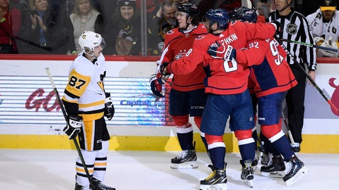 <p>               Pittsburgh Penguins center Sidney Crosby (87) skates by as members of the Washington Capitals including left wing Alex Ovechkin (8), of Russia, and center Evgeny Kuznetsov (92), of Russia, celebrate a goal by right wing T.J. Oshie, second from left, during the third period of an NHL hockey game, Wednesday, Nov. 7, 2018, in Washington. The Capitals won 2-1. (AP Photo/Nick Wass)             </p>