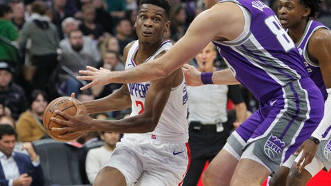 <p>               LA Clippers guard Shai Gilgeous-Alexander (2) drives to the basket against Sacramento Kings forward Nemanja Bjelica (88) during the first half of an NBA basketball game in Sacramento, Calif., Thursday, Nov. 29, 2018. (AP Photo/Steve Yeater)             </p>