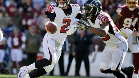 <p>               FILE - In this Sunday, Nov. 4, 2018, file photo, Atlanta Falcons quarterback Matt Ryan (2) fakes a handoff to running back Ito Smith (25) during an NFL football game against the Washington Redskins, in Landover, Md. Ryan is playing like he did as an MVP in 2016, throwing 10 touchdown passes and just three interceptions. (AP Photo/Mark Tenally, File)             </p>