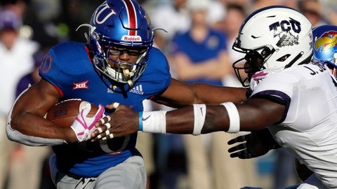 <p>               Kansas running back Khalil Herbert (10) stiff arms TCU linebacker Jawuan Johnson, right, during the second half of an NCAA college football game in Lawrence, Kan., Saturday, Oct. 27, 2018. (AP Photo/Orlin Wagner)             </p>